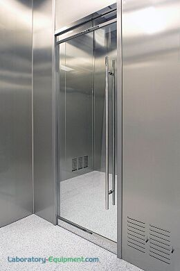 """Frameless all-glass cleanroom doors are configured to easily install to either Terra's modular cleanrooms or traditional brick-and-mortar (""""stick built"""") rooms 