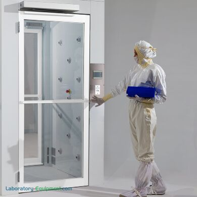 Powder-Coated Aluminum Automatic door opener with motion sensor allows hands-free door operation (shown installed above Air Shower entrance)