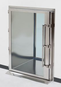 Floor-mounted pass-through chamber with swing-out door
